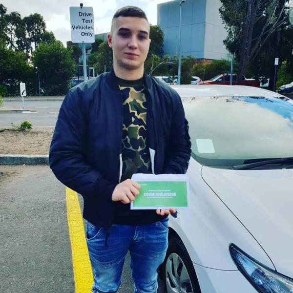 Alex with his Probationary Licence after the Driving Test.